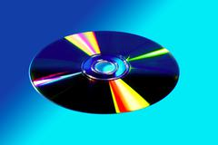 CD DVD disk with colorful reflexion - stock photo