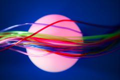 Glowing sphere with colorful wires such a wired communication - stock photo