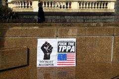 Thousands march against TPP trade agreement in Auckland - New Zealand - stock photo