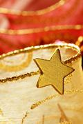 Christmas golden decoration with gold star Stock Photos