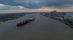 Container ship on Mississippi River, Sunset over skyline, New Orleans, LA, - stock footage