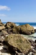 rock formation on coastline at Nusa Penida island - stock photo