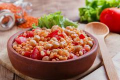 chickpea dish orange lentil and tomato - stock photo