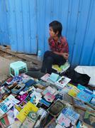 YANGON, BURMA - DECEMBER 23, 2013 - View of Youthful .Sidewalk Bookseller Stock Photos