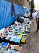 YANGON, BURMA - DECEMBER 23, 2013 - View of Sidewalk Booksellers Stock Photos