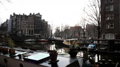 Amsterdam, The Netherlands. Holland. Canal, boat house - stock footage