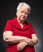 Portrait of pensive old woman - stock photo