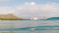 Longboarders surfing at waikiki Stock Footage