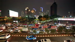Jakarta night rush in Central Business district Stock Footage
