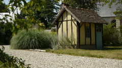 Timbered house and botanical garden Stock Footage