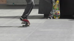 Slow Motion Teenage Boy Performing Skate Board KickFlip Ollie For Friends Stock Footage