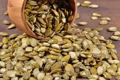 Cleared pumpkin seeds in a bowl - stock photo