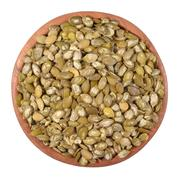 Cleared pumpkin seeds in a wooden bowl on a white - stock photo