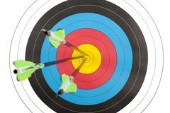 Archery target hit by three arrows Kuvituskuvat