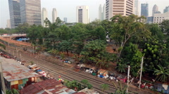 Commuter train in Jakarta business district Stock Footage