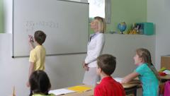 Teaching to Do Sums Stock Footage