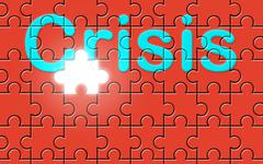 Crisis text written on a puzzle background - stock photo