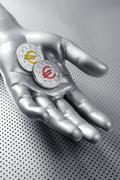 Futuristic euro business coin silver hand Stock Photos