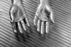 Hands open futuristic robot silver steel over gray Stock Photos