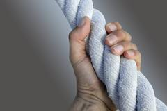 man hand grab grip strong big aged rope - stock photo