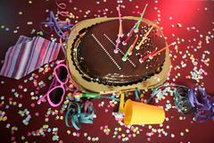 Chocolate holiday party cake on a messy table Stock Photos