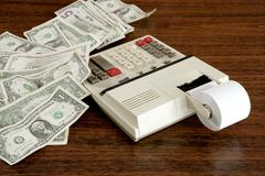 dollar notes calculator accountant office vintage - stock photo