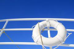 boat buoy white hanged in railing summer blue sky - stock photo