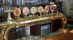 Array of draught beers served by taps of the 'St. Norbert ' pub Stock Footage