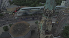 Aerial view of Kaiser Wilhelm Memorial Church and Budapester Street, Berlin Stock Footage