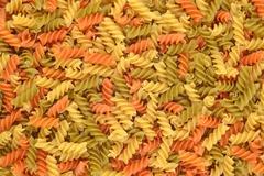 Italian pasta fusilli background. - stock photo