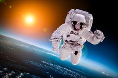 Astronaut in outer space - stock photo