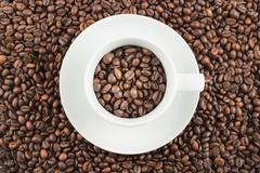 Ceramic cup full of coffee beans Stock Photos