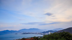 view of clouds at dawn over sea bay mountains and city on coast - stock footage