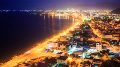 View of night city shore in lights with coast road traffic Stock Footage