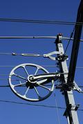 Electric railway steel infrastructure over blue sky Stock Photos