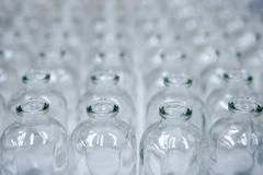 Glass transparent empty bottles assembly line - stock photo