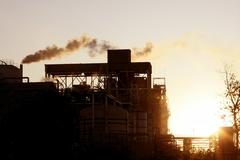 Backlight petrochemical industry smoke sky - stock photo