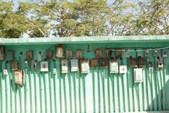electricity meter wall in mexico outdoor green - stock photo