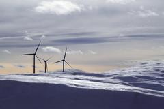 Aerogenerator electric windmills snow mountain Stock Photos