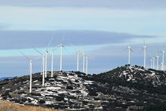 electric aerogenerator windmills snow winter - stock photo
