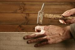 Carpenter hands with hammer wood and nail Kuvituskuvat