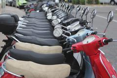 Stock Photo of scooter mototbikes row many in rent store
