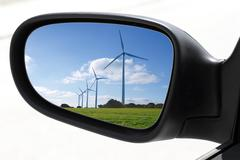 Rearview car driving mirror electric windmills Stock Photos