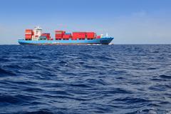 Sea cargo merchant ship sailing blue ocean Kuvituskuvat