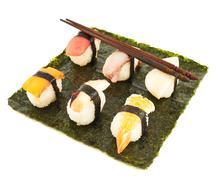 Nigirizushi sushi over nori sheet - stock photo