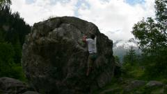 Bouldering in alpine meadow Chamonix - stock footage