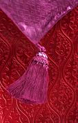 Red wallpaper, and pink purple braid Stock Photos