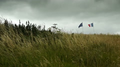 National flags at D Day Beach at Arromanches, France Stock Footage