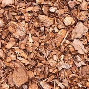 Wooden mulch ground fragment - stock photo