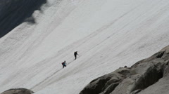 Climbing team going up snow slope Chamonix Stock Footage